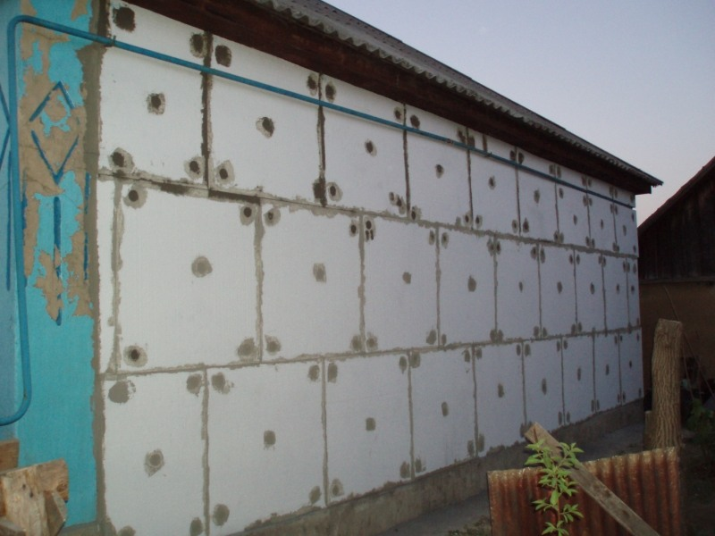 Отделка фасада дома деревянными элементами