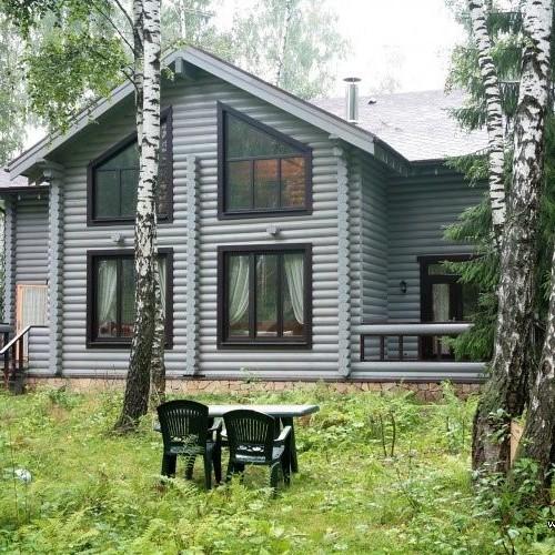 Частный дом с отделкой фасада в стиле кантри
