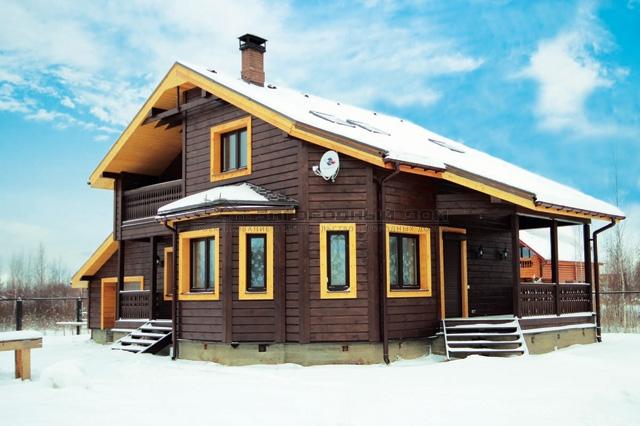 Утепленный деревянный дом при помощи сайдинга