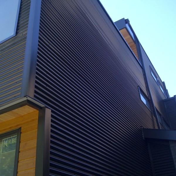 облицовка деревянного дома металлическим сайдингом