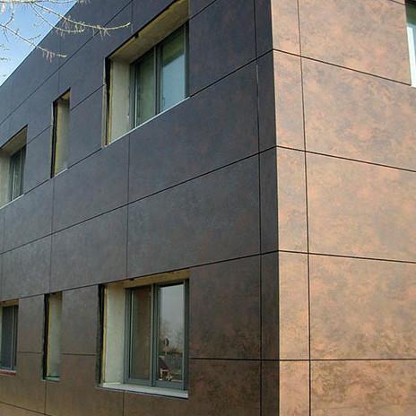 Отделка фасада керамогранитом требует определенных подрезок на фасаде